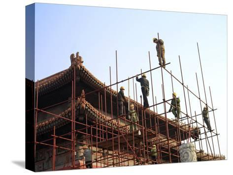 Workers Climb Scaffolding on the Palace Roof in the Forbidden City-xPacifica-Stretched Canvas Print