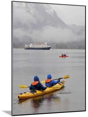 Kayaking in Khutze Inlet Near a Cruise Ship-Michael Melford-Mounted Photographic Print
