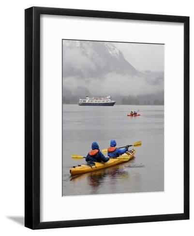Kayaking in Khutze Inlet Near a Cruise Ship-Michael Melford-Framed Art Print