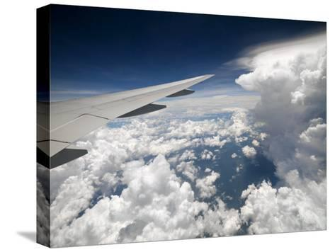 View of Clouds, Airplane Wing and the Sun from Window-xPacifica-Stretched Canvas Print