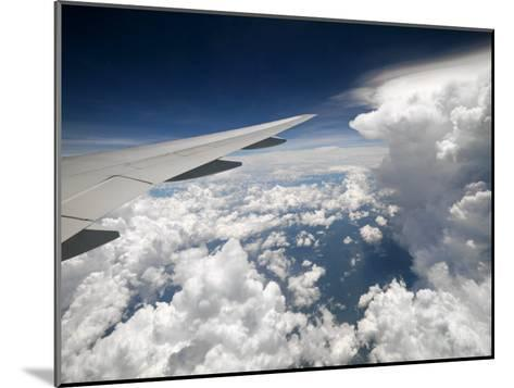 View of Clouds, Airplane Wing and the Sun from Window-xPacifica-Mounted Photographic Print