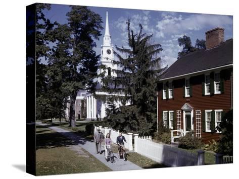 People Pass Typical New England Colonial-Style Clapboard House-B^ Anthony Stewart-Stretched Canvas Print