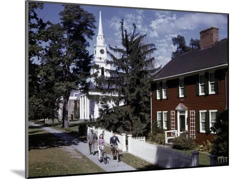 People Pass Typical New England Colonial-Style Clapboard House-B^ Anthony Stewart-Mounted Photographic Print