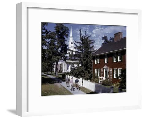 People Pass Typical New England Colonial-Style Clapboard House-B^ Anthony Stewart-Framed Art Print