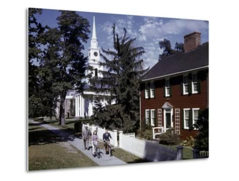 People Pass Typical New England Colonial-Style Clapboard House-B^ Anthony Stewart-Metal Print