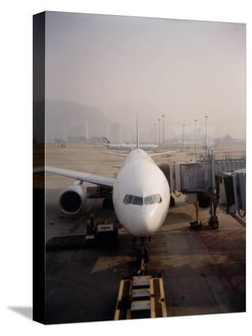 Jumbo Airplane Parked on the Tarmac at the Airport in Hong Kong-xPacifica-Stretched Canvas Print