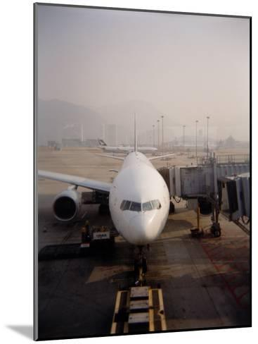 Jumbo Airplane Parked on the Tarmac at the Airport in Hong Kong-xPacifica-Mounted Photographic Print