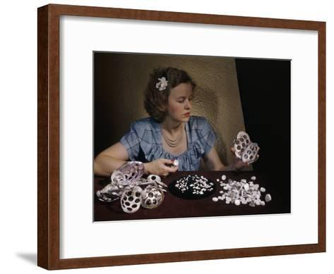 Woman Holds Mussel Shells and Pearl Buttons Made from Those Shells-Willard Culver-Framed Art Print