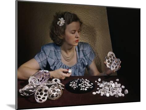 Woman Holds Mussel Shells and Pearl Buttons Made from Those Shells-Willard Culver-Mounted Photographic Print