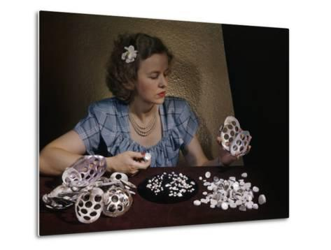 Woman Holds Mussel Shells and Pearl Buttons Made from Those Shells-Willard Culver-Metal Print