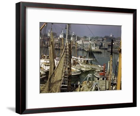 Commercial Fishing Boats of All Sizes Crowd the Town's Busy Harbor-B^ Anthony Stewart-Framed Art Print