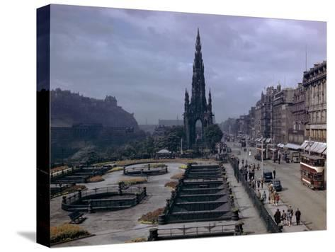 Pedestrians and Trams Pass Gardens and Memorial on Princes Street-B^ Anthony Stewart-Stretched Canvas Print