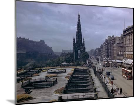 Pedestrians and Trams Pass Gardens and Memorial on Princes Street-B^ Anthony Stewart-Mounted Photographic Print