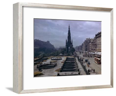 Pedestrians and Trams Pass Gardens and Memorial on Princes Street-B^ Anthony Stewart-Framed Art Print