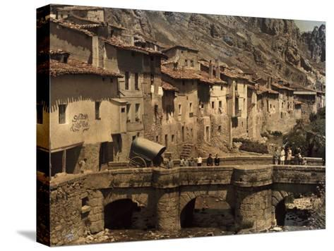 People Stand on a Bridge in the Town of Pancorbo-Gervais Courtellemont-Stretched Canvas Print