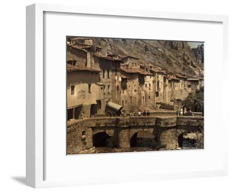 People Stand on a Bridge in the Town of Pancorbo-Gervais Courtellemont-Framed Art Print