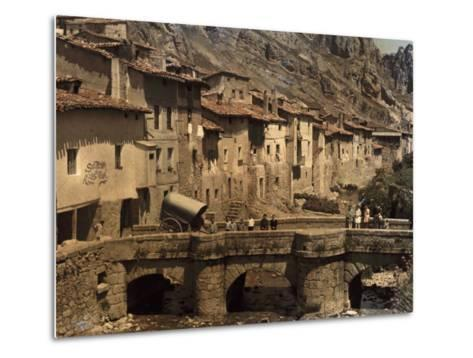 People Stand on a Bridge in the Town of Pancorbo-Gervais Courtellemont-Metal Print