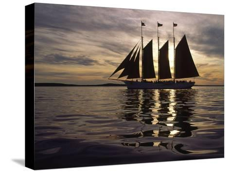 Three Masted Schooner under Sail at Sunset-Michael Melford-Stretched Canvas Print