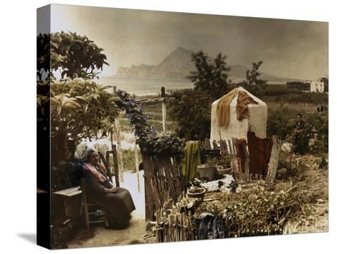 Woman Sits in Her Garden in Altea-Gervais Courtellemont-Stretched Canvas Print