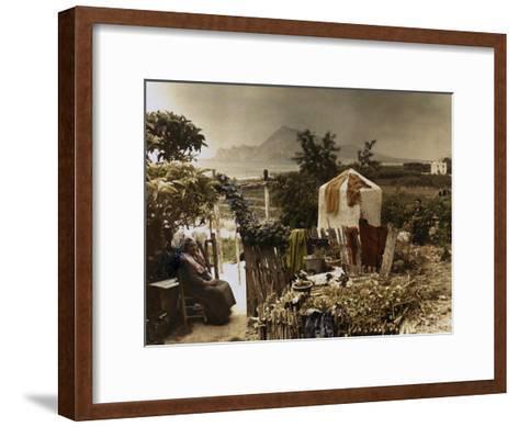 Woman Sits in Her Garden in Altea-Gervais Courtellemont-Framed Art Print