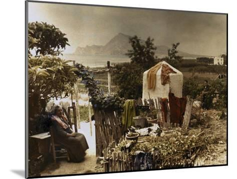 Woman Sits in Her Garden in Altea-Gervais Courtellemont-Mounted Photographic Print
