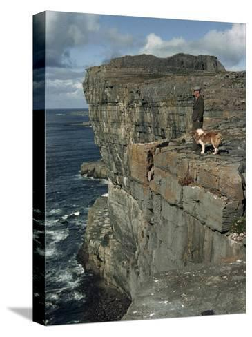 Irishman with His Dog Admire the View of the Ocean from a Cliff-Howell Walker-Stretched Canvas Print