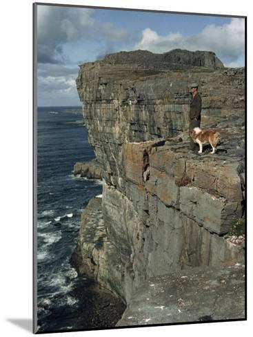 Irishman with His Dog Admire the View of the Ocean from a Cliff-Howell Walker-Mounted Photographic Print