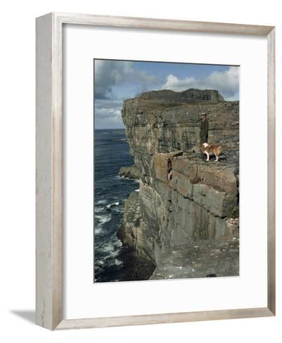 Irishman with His Dog Admire the View of the Ocean from a Cliff-Howell Walker-Framed Art Print