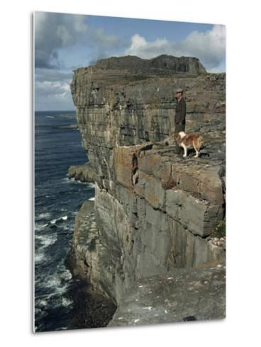 Irishman with His Dog Admire the View of the Ocean from a Cliff-Howell Walker-Metal Print