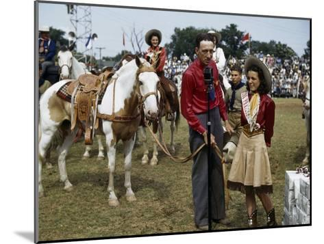 Winner at a Rodeo Receives a Prize Pony-B^ Anthony Stewart-Mounted Photographic Print