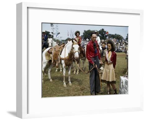 Winner at a Rodeo Receives a Prize Pony-B^ Anthony Stewart-Framed Art Print