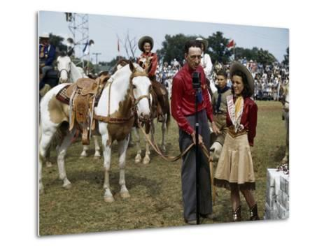 Winner at a Rodeo Receives a Prize Pony-B^ Anthony Stewart-Metal Print