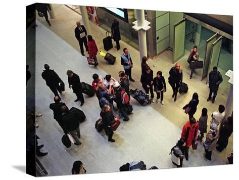 Travelers from Paris Arrive in London on the Eurostar High-Speed Train-Steve Raymer-Stretched Canvas Print