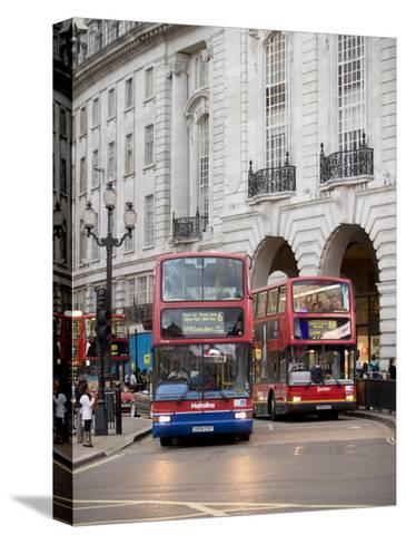 London Buses Passing the Alliance Life Building in Piccadilly Circus-xPacifica-Stretched Canvas Print
