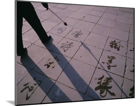 Man Paints Chinese Calligraphy in Water with a Long Modified Brush-xPacifica-Mounted Photographic Print