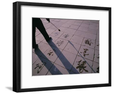 Man Paints Chinese Calligraphy in Water with a Long Modified Brush-xPacifica-Framed Art Print