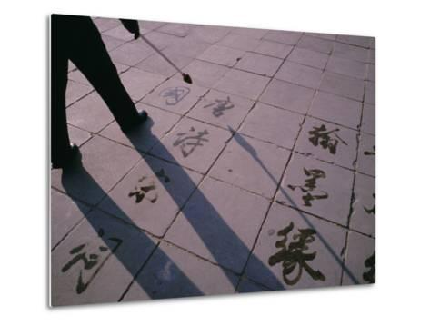 Man Paints Chinese Calligraphy in Water with a Long Modified Brush-xPacifica-Metal Print
