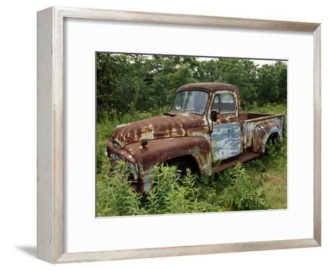 Abandoned Truck Rests in a Patch of Overgrown Grasses and Bushes-Paul Damien-Framed Art Print