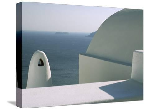 Classic Greek View of Whitewashed Buildings Overlooking the Sea--Stretched Canvas Print