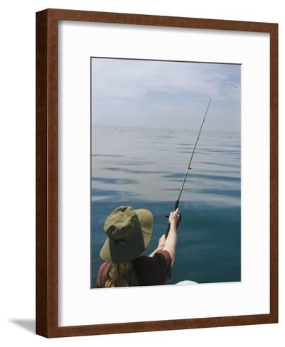 Young Woman Fishing from a Motor Boat-James Forte-Framed Art Print