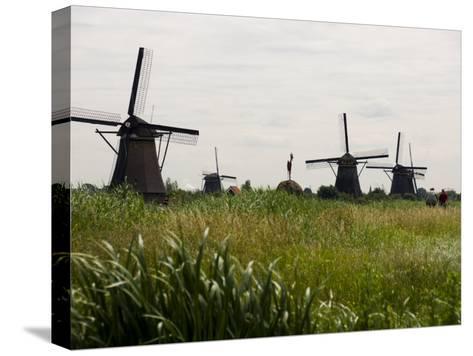 Windmills in a Field in the Netherlands-Mattias Klum-Stretched Canvas Print