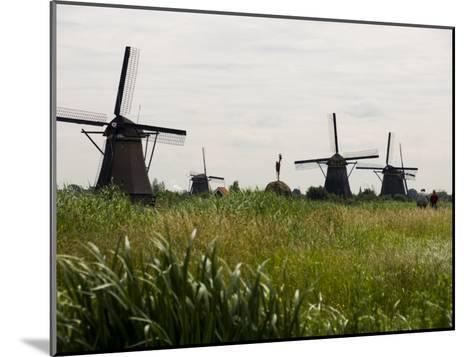 Windmills in a Field in the Netherlands-Mattias Klum-Mounted Photographic Print