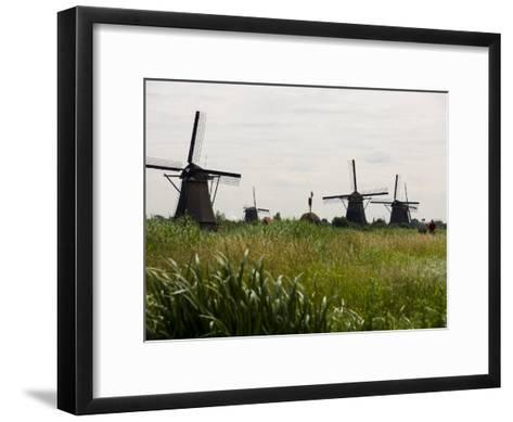 Windmills in a Field in the Netherlands-Mattias Klum-Framed Art Print