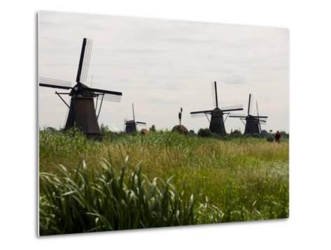 Windmills in a Field in the Netherlands-Mattias Klum-Metal Print