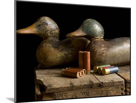 Antique Duck Decoys and Shotgun Shells Sit on an Old Wooden Crate-Joel Sartore-Mounted Photographic Print