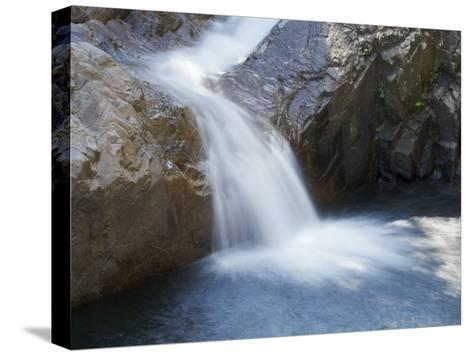 Small Waterfall Cascading over Rough Rocks-Tim Laman-Stretched Canvas Print