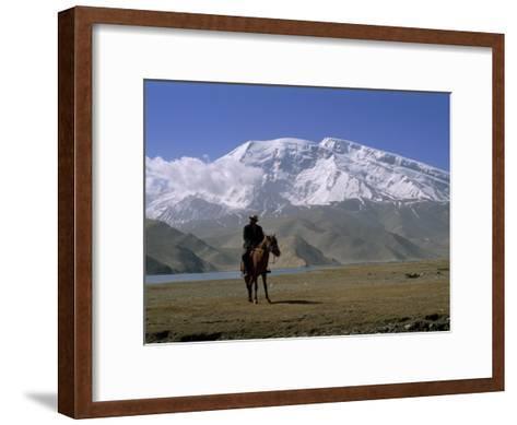 Khyrgiz Nomad Rides by Lake Karakul under 7546M Mustagh Ata-Gordon Wiltsie-Framed Art Print