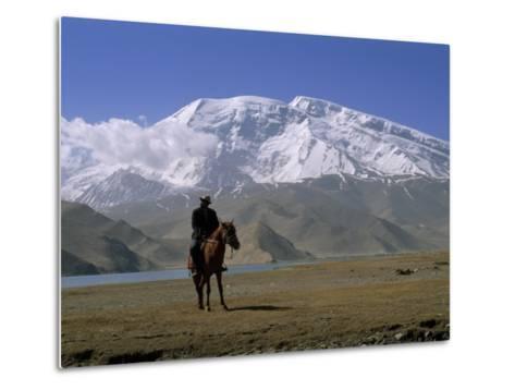 Khyrgiz Nomad Rides by Lake Karakul under 7546M Mustagh Ata-Gordon Wiltsie-Metal Print