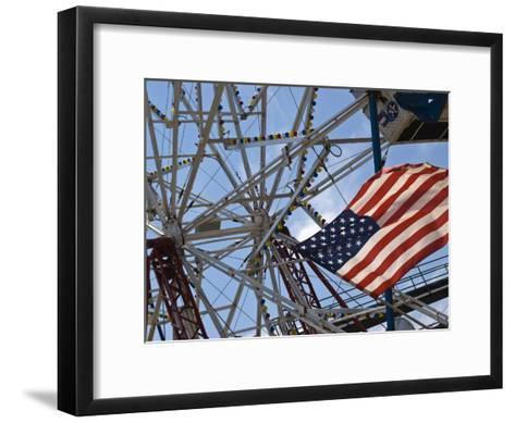 Flag in Front of a Ferris Wheel Against a Summer Sky-Todd Gipstein-Framed Art Print