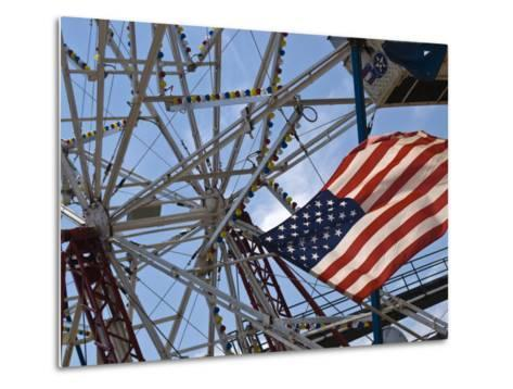 Flag in Front of a Ferris Wheel Against a Summer Sky-Todd Gipstein-Metal Print